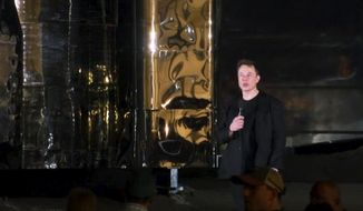 In this image made from video provided by SpaceX, Elon Musk speaks of SpaceX's newly designed aircraft at its launch facility near Brownsville, Texas, Saturday, Sept. 28, 2019. Musk unveiled Saturday the SpaceX spacecraft designed to carry a crew and cargo to the moon, Mars or anywhere else in the solar system and land back on Earth perpendicularly. (SpaceX via AP)