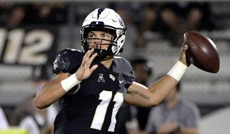 Central Florida quarterback Dillon Gabriel (11) throws a pass during the first half of an NCAA college football game against Connecticut, Saturday, Sept. 28, 2019, in Orlando, Fla. (AP Photo/Phelan M. Ebenhack)