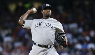 New York Yankees starting pitcher Luis Severino (40) throws during the first inning of a baseball game against the Texas Rangers, Saturday, Sept. 28, 2019, in Arlington, Texas. (AP Photo/Brandon Wade)