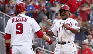 Washington Nationals' Brian Dozier (9) and Wilmer Difo (1) celebrate after scoring on a double by Gerardo Parra during the sixth inning of a baseball game against the Cleveland Indians at Nationals Park, Sunday, Sept. 29, 2019, in Washington. (AP Photo/Andrew Harnik) ** FILE **