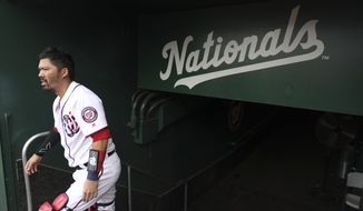 Washington Nationals catcher Kurt Suzuki (28) takes the field before a baseball game against the Cleveland Indians at Nationals Park, Sunday, Sept. 29, 2019, in Washington. (AP Photo/Andrew Harnik)