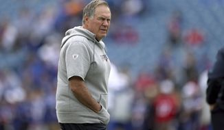 New England Patriots head coach Bill Belichick watches the team warm up before an NFL football game against the Buffalo Bills, Sunday, Sept. 29, 2019, in Orchard Park, N.Y. (AP Photo/Ron Schwane)