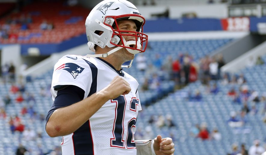 New England Patriots quarterback Tom Brady charges onto the field before an NFL football game against the Buffalo Bills, Sunday, Sept. 29, 2019, in Orchard Park, N.Y. (AP Photo/Ron Schwane)