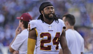Washington Redskins' Josh Norman on the sidelines during the second half of an NFL football game against the New York Giants, Sunday, Sept. 29, 2019, in East Rutherford, N.J. (AP Photo/Adam Hunger) ** FILE **