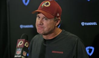 Washington Redskins head coach Jay Gruden talks to reporters after an NFL football game against the New York Giants, Sunday, Sept. 29, 2019, in East Rutherford, N.J. The Giants defeated the Redskins 24-3. (AP Photo/Adam Hunger)
