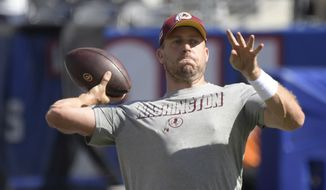 Washington Redskins quarterback Case Keenum warms-up before an NFL football game against the New York Giants, Sunday, Sept. 29, 2019, in East Rutherford, N.J. (AP Photo/Bill Kostroun) **FILE**
