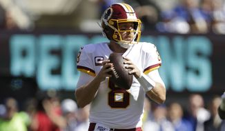Washington Redskins quarterback Case Keenum looks to throw during the first half of an NFL football game against the New York Giants, Sunday, Sept. 29, 2019, in East Rutherford, N.J. (AP Photo/Adam Hunger)