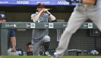 Milwaukee Brewers manager Craig Counsell, center, looks on during the 10th inning against the Colorado Rockies in a baseball game Sunday, Sept. 29, 2019, in Denver. (AP Photo/John Leyba)