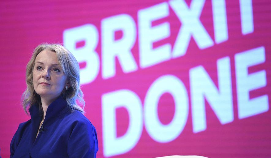 Britain's International Trade Secretary Liz Truss on stage at the Conservative Party Conference being held in Manchester, England, Sunday Sept.29, 2019.  The Conservative Party is committed to Britain's Brexit split from the European Union  leaving on the scheduled date of Oct. 31. (Stefan Rousseau/PA via AP)