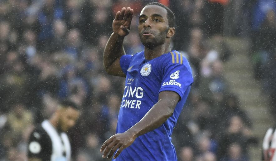 Leicester's Ricardo Pereira celebrates after scoring the opening goal under heavy rain during the English Premier League soccer match between Leicester City and Newcastle United at the King Power Stadium in Leicester, England, Sunday, Sept. 29, 2019. (AP Photo/Rui Vieira)