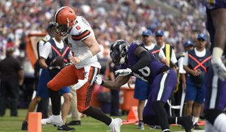 Cleveland Browns quarterback Baker Mayfield (6) is pushed out of bounds by Baltimore Ravens inside linebacker Patrick Onwuasor (48) during the first half of an NFL football game Sunday, Sept. 29, 2019, in Baltimore. (AP Photo/Gail Burton)