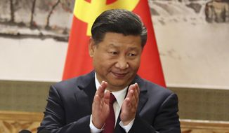 "FILE - In this Oct. 25, 2017, file photo, Chinese President Xi Jinping claps while addressing the media as he introduces new members of the Politburo Standing Committee at Beijing's Great Hall of the People. Xi has an ambitious goal for China: to achieve ""national rejuvenation"" as a strong and prosperous nation by 2049, which would be the 100th anniversary of Communist Party rule. One problem: U.S. President Donald Trump wants to make the United States great again too. (AP Photo/Ng Han Guan, File)"