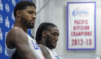 Los Angeles Clippers forwards Paul George, left, and Montrezl Harrell attend the NBA basketball team's media day in Los Angeles, Sunday, Sept. 29, 2019. (AP Photo/Ringo H.W. Chiu)