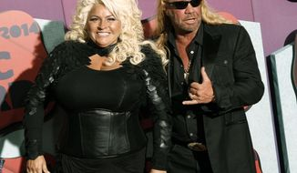 """FILE - In this June 4, 2014 file photo, Beth Chapman, left, and Duane Chapman arrive at the CMT Music Awards at Bridgestone Arena, in Nashville, Tenn. Chapman, known to millions as the star of the """"Dog the Bounty Hunter"""" reality TV show, tells People magazine that he is facing his own medical problems after the death of his wife from cancer. Chapman, 66, appeared on an episode of """"The Dr. Oz Show"""" on Monday, Sept. 23, 2019, in which he learned that he's suffering from a pulmonary embolism in the heart - meaning one or more of his arteries has been blocked by blood. (Photo by Wade Payne/Invision/AP, File)"""