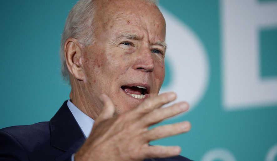 In this Aug. 3, 2019, file photo, former Vice President and Democratic presidential candidate Joe Biden speaks during a public employees union candidate forum in Las Vegas. (AP Photo/John Locher)
