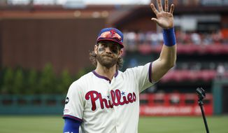 Philadelphia Phillies' Bryce Harper waves before addressing the crowd at Citizens Bank Park before a baseball game against the Miami Marlins, Sunday, Sept. 29, 2019, in Philadelphia. (AP Photo/Matt Slocum) ** FILE **