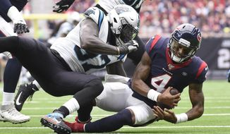 Houston Texans quarterback Deshaun Watson (4) is sacked by Carolina Panthers linebacker Mario Addison (97) during the first half of an NFL football game Sunday, Sept. 29, 2019, in Houston. (AP Photo/Eric Christian Smith)