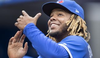 Toronto Blue Jays' Vladimir Guerrero Jr. gestures to fans during a baseball game against the Tampa Bay Rays in Toronto, Sunday, Sept. 29, 2019. (Fred Thornhill/The Canadian Press via AP)