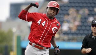 Cincinnati Reds' Aristides Aquino (44) rounds third base after hitting a solo home run off Pittsburgh Pirates starting pitcher Trevor Williams during the second inning of a baseball game in Pittsburgh, Sunday, Sept. 29, 2019. (AP Photo/Gene J. Puskar)