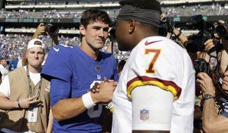 New York Giants quarterback Daniel Jones, left, greets Washington Redskins quarterback Dwayne Haskins after an NFL football game, Sunday, Sept. 29, 2019, in East Rutherford, N.J. The Giants defeated the Redskins 24-3. (AP Photo/Adam Hunger)