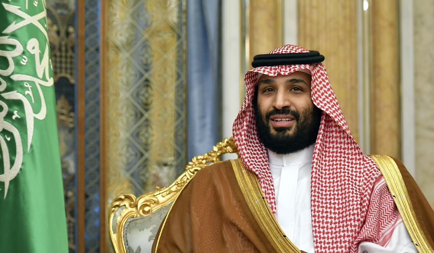 """In this Sept. 18, 2019, file photo, Saudi Arabia's Crown Prince Mohammed bin Salman attends a meeting with U.S. Secretary of State Mike Pompeo in Jeddah, Saudi Arabia. The crown prince said in a television interview that aired Sunday, Sept. 29, that he takes """"full responsibility"""" for the grisly murder of Saudi journalist Jamal Khashoggi, but denied allegations that he ordered it. (Mandel Ngan/Pool Photo via AP, File)"""