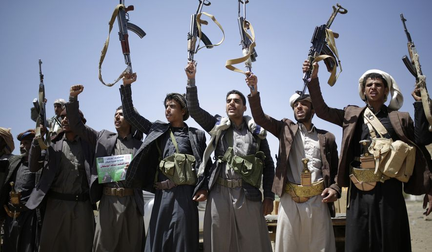 In this Sept. 21, 2019 file photo, Shiite Houthi tribesmen hold their weapons as they chant slogans during a tribal gathering showing support for the Houthi movement, in Sanaa, Yemen.  Yemen's Houthi rebels said late Friday night that they were halting drone and missile attacks against Saudi Arabia, one week after they claimed responsibility for a strike that crippled a key oil facility in the kingdom. (AP Photo/Hani Mohammed) **FILE**
