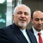 In this Sept. 23, 2019, file photo, Iranian Foreign Minister Mohammad Javad Zarif, left, arrives for the 74th session of the United Nations General Assembly, at U.N. headquarters. Iran on Saturday criticized the United States for what it called an inhumane decision to bar its foreign minister who was attending the U.N. summit meetings in New York from visiting a hospitalized Iranian diplomat in the city. (AP Photo/Craig Ruttle, File) **FILE**