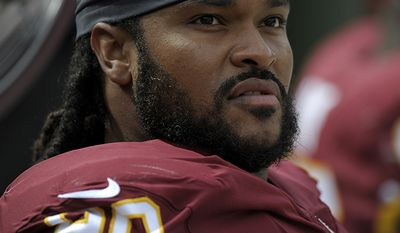ZIGGY HOOD                                                                                                        Washington Redskins defensive tackle Ziggy Hood looks at the scoreboard during an NFL football game against the Indianapolis Colts, Sunday, Sept. 16, 2018, in Landover, Md. (AP Photo/Mark Tenally)