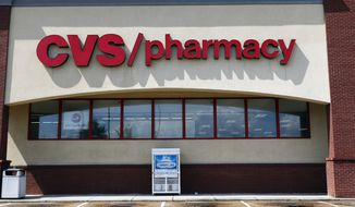 In this Aug. 7, 2018, file photo, a CVS Pharmacy building sign rests on a Jackson, Miss., store. CVS has halted sales of popular heartburn treatment Zantac and the store generic version after warnings by U.S. health regulators. Earlier this month, the U.S. Food and Drug Administration warned consumers about a potentially dangerous contaminant in prescription and over-the-counter versions of Zantac. In its announcement this weekend, CVS said customers who bought Zantac products can return them for a refund.  (AP Photo/Rogelio V. Solis, File)