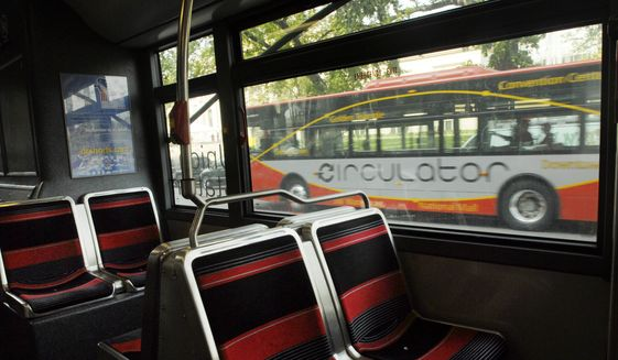 The DC Circulator bus is shown in this file photo from Wednesday, October 4, 2006. ( Daniel Rosenbaum  / The Washington Times ) **FILE**