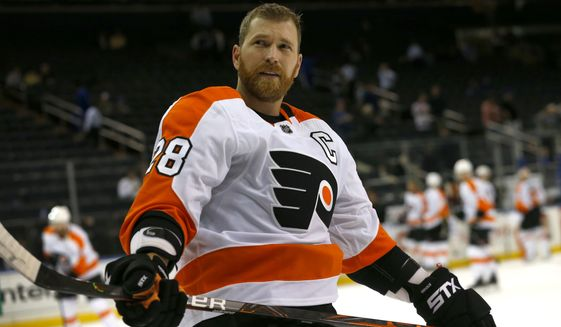 Philadelphia Flyers center Claude Giroux (28) during warm up before an NHL preseason hockey game, against the NewYork Rangers. Thursday, Sept. 26,2019, in New York. (AP Photo/Noah K. Murray) ** FILE **
