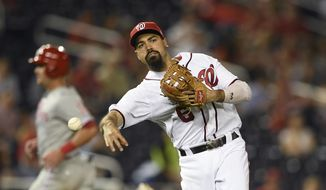 Washington Nationals third baseman Anthony Rendon (6) throws to first to get out Philadelphia Phillies' Jean Segura during the third inning of a baseball game, Monday, Sept. 23, 2019, in Washington. (AP Photo/Nick Wass)