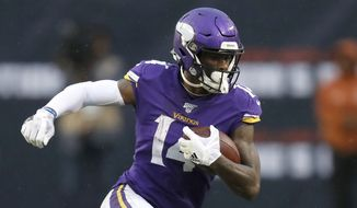 Minnesota Vikings' Stefon Diggs advances the ball during the second half of an NFL football game against the Chicago Bears Sunday, Sept. 29, 2019, in Chicago. (AP Photo/Charles Rex Arbogast)