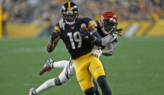 Pittsburgh Steelers wide receiver JuJu Smith-Schuster (19) is tackled by Cincinnati Bengals cornerback Dre Kirkpatrick (27) during the first half of an NFL football game in Pittsburgh, Monday, Sept. 30, 2019. (AP Photo/Tom Puskar) ** FILE **