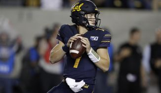 California quarterback Chase Garbers prepares to pass against Arizona State in the first half of an NCAA college football game Friday, Sept. 27, 2019, in Berkeley, Calif. (AP Photo/Ben Margot)