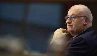 European Commissioner designate for Trade Phil Hogan answers questions during his hearing at the European Parliament in Brussels, Monday, Sept. 30, 2019. (AP Photo/Virginia Mayo)
