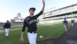 Colorado Rockies starting pitcher Kyle Freeland, center, waves to the crowd after a win over the Milwaukee Brewers in 13 innings of a baseball game Sunday, Sept. 29, 2019, in Denver. (AP Photo/John Leyba)