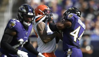 In this Sunday, Sept. 29, 2019, file photo, Cleveland Browns wide receiver Odell Beckham, center, and Baltimore Ravens cornerback Marlon Humphrey (44) grab each other during the second half of an NFL football game in Baltimore. Browns coach Freddie Kitchens wants more consistent NFL officiating after wide receiver Odell Beckham Jr. was choked during Sunday's game. Beckham got into a skirmish with Ravens cornerback Marlon Humphrey, who pinned the three-time Pro Bowler and had his hands around his neck before being pulled away. Both players were assessed personal fouls, but neither was ejected. Kitchens said he planned to reach out to the league about that situation in particular and officiating evenness in general. (AP Photo/Nick Wass, File) **FILE**