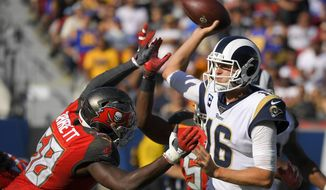 Los Angeles Rams quarterback Jared Goff, right, passes under pressure from Tampa Bay Buccaneers linebacker Shaquil Barrett during the second half of an NFL football game Sunday, Sept. 29, 2019, in Los Angeles. (AP Photo/Mark J. Terrill)