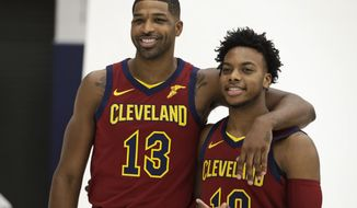 Cleveland Cavaliers' Tristan Thompson, left, and Darius Garland pose for a photo during the NBA basketball team's media day, Monday, Sept. 30, 2019, in Independence, Ohio. (AP Photo/Tony Dejak)