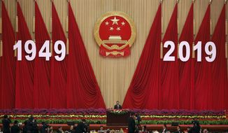 Chinese President Xi Jinping delivers a speech at a dinner marking the 70th anniversary of the founding of the People's Republic of China at the Great Hall of the People in Beijing, Monday, Sept. 30, 2019. Xi on Monday renewed his government's commitment to allowing Hong Kong to manage its own affairs amid continuing anti-government protests in the semi-autonomous Chinese territory. (AP Photo/Andy Wong)