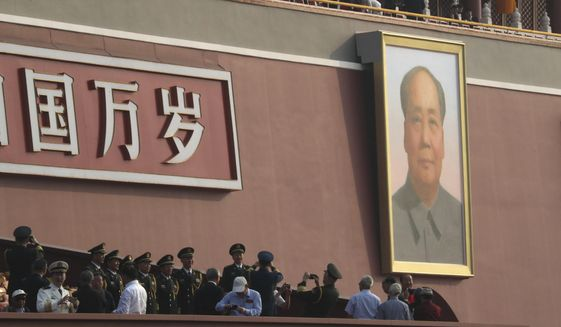 The large portrait of former Chinese leader Mao Zedong is seen on Tiananmen Gate near Tiananmen Square in Beijing, before the start of a parade to mark the 70th anniversary of the founding of the People's Republic of China in Beijing on Tuesday, Oct. 1, 2019. (AP Photo/Ng Han Guan)