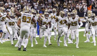 New Orleans Saints' Vonn Bell (24) and the rest of the defense celebrate after an interception against the Dallas Cowboys during an NFL football game, Sunday, Sept. 29, 2019, in New Orleans. (Scott Clause/The Daily Advertiser via AP)