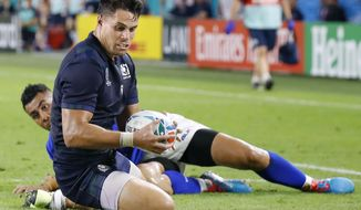 Scotland's Sean Maitland scores a try during the Rugby World Cup Pool A game at Kobe Misaki Stadium between Scotland and Samoa in Kobe, western Japan, Monday, Sept. 30, 2019. (Kyodo News via AP)