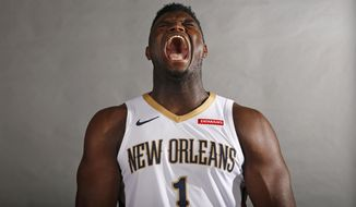 New Orleans Pelicans first round draft pick Zion Williamson lets out a fake yell during a photo shoot during their NBA basketball media day in Metairie, La., Monday, Sept. 30, 2019. (AP Photo/Gerald Herbert)