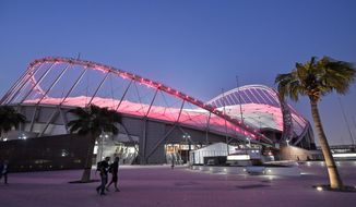 The Khalifa International Stadium shines in the evening prior to the start of the World Athletics Championships in Doha, Qatar, Thursday, Sept. 26, 2019. (AP Photo/Martin Meissner)