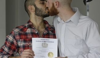 FILE - In this April 3, 2014, file photo, Derek Kitchen, right, and Moudi Sbeity kiss as they hold their certificate of mutual commitment at their home, in Salt Lake City. Kitchen, a Utah state lawmaker who filed a lawsuit that successfully overturned the state's ban on same-sex marriage, is separating from his husband. Sen. Kitchen announced in an Instagram post Sunday, Sept. 29, 2019, that he and Sbeity have decided to divorce. (AP Photo/Rick Bowmer, File)