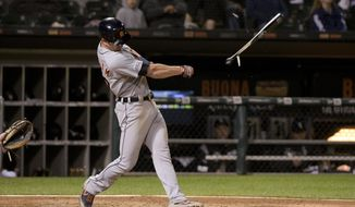 Detroit Tigers Gordon Beckham (29) breaks his bat on a single during the sixth inning of game two of a baseball doubleheader against the Chicago White Sox, Saturday, Sept. 28, 2019, in Chicago. (AP Photo/Mark Black)