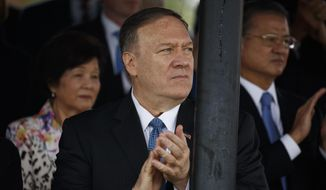 Secretary of State Mike Pompeo looks on during an Armed Forces welcome ceremony for the new chairman of the Joint Chiefs of Staff Gen. Mark Milley, Monday, Sept. 30, 2019, at Joint Base Myer-Henderson Hall, Va. (AP Photo/Evan Vucci)