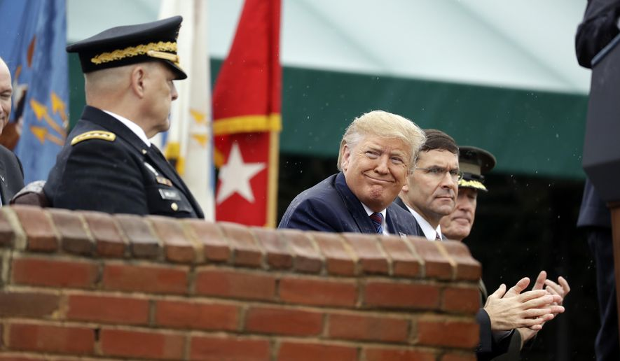 President Donald Trump participates in an Armed Forces welcome ceremony for the new chairman of the Joint Chiefs of Staff, Gen. Mark Milley, left, Monday, Sept. 30, 2019, at Joint Base Myer-Henderson Hall, Va. From left are Chairman of the Joint Chiefs of Staff, Gen. Mark Milley, Trump, Secretary of Defense Mark Esper and Gen. Joseph Dunford, former chairman. (AP Photo/Evan Vucci)